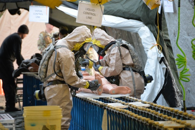New York Army National Guard Soldiers of the Homeland Response Force for FEMA Region 2 move a simulated casualty through decontamination during an exercise for chemical, biological, radiological or nuclear (CBRN) incident response training at Lakehurst Naval Air Station at Joint Base McGuire Dix Lakehurst in Lakehurst, N.J. November 15, 2019. Decontamination team members are assigned to the 642nd Support Battalion and cross-trained for the CBRN response skills needed for decontamination. More than 600 Soldiers and Airmen of the New York and New Jersey National Guard participated in the training to prepare for the task force capabilities to conduct casualty evacuation, decontamination and medical triage under CBRN conditions.