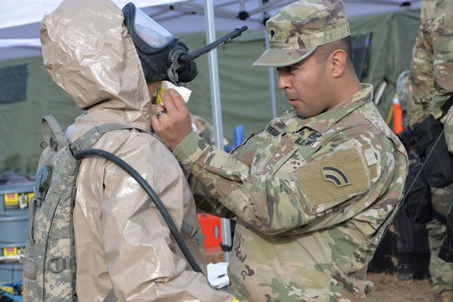 New York Army National Guard Soldiers of the Homeland Response Force for FEMA Region 2 prepare themselves for decontamination operations during an exercise for chemical, biological, radiological or nuclear (CBRN) incident response training at Lakehurst Naval Air Station at Joint Base McGuire Dix Lakehurst in Lakehurst, N.J. November 15, 2019. Decontamination team members are assigned to the 642nd Support Battalion and cross-trained for the CBRN response skills needed for decontamination. More than 600 Soldiers and Airmen of the New York and New Jersey National Guard participated in the training to prepare for the task force capabilities to conduct casualty evacuation, decontamination and medical triage under CBRN conditions.