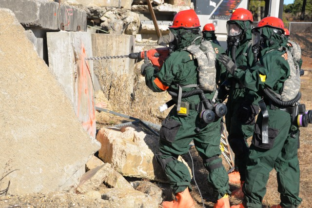 New York Army National Guard search and extraction team members assigned to Bravo Company, 152nd Brigade Engineer Battalion, practice techniques for rescues in collapsed buildings, including drilling through cement obstacles in confined spaces during Homeland Response Force training at Lakehurst Naval Air Station at Joint Base McGuire Dix Lakehurst in Lakehurst, N.J. November 16, 2019. The engineers serve as part of the Homeland Response Force for FEMA Region 2 and conducted response training for chemical, biological, radiological or nuclear (CBRN) incidents. More than 600 Soldiers and Airmen of the New York and New Jersey National Guard participated in the training to prepare for the task force capabilities to conduct casualty evacuation, decontamination and medical triage under CBRN conditions.