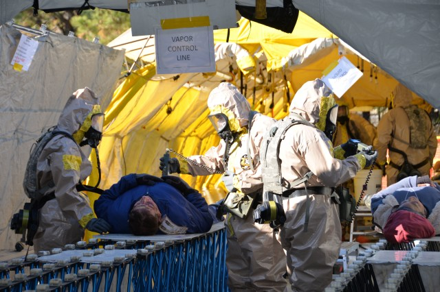 New York Army National Guard Soldiers of the Homeland Response Force for FEMA Region 2 move a simulated casualty through decontamination during an exercise for chemical, biological, radiological or nuclear (CBRN) incident response training at Lakehurst Naval Air Station at Joint Base McGuire Dix Lakehurst in Lakehurst, N.J. November 16, 2019. Decontamination team members are assigned to the 642nd Support Battalion and cross-trained for the CBRN response skills needed for decontamination. More than 600 Soldiers and Airmen of the New York and New Jersey National Guard participated in the training to prepare for the task force capabilities to conduct casualty evacuation, decontamination and medical triage under CBRN conditions.