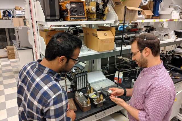University of Maryland graduate research assistant Harsimran Singh (left) and assistant research scientist Dr. Raphael Mandel discuss the workings of the ultra-high heat flux cooler.