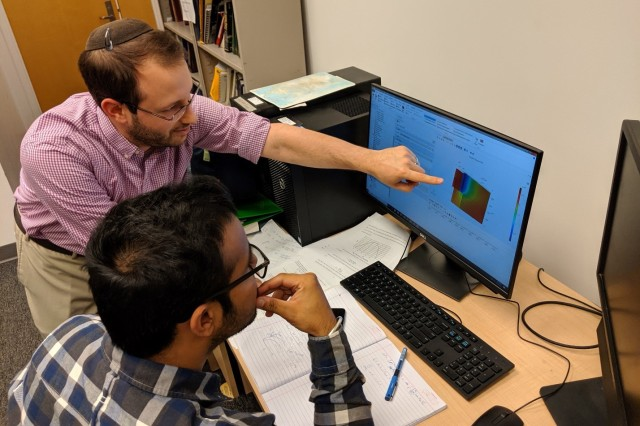 University of Maryland assistant research scientist Dr. Raphael Mandel (left) and graduate research assistant Harsimran Singh use custom-coded model in Engineering Equation Solver software to perform a simulation of the flow distribution in the ultra-high heat flux cooler.
