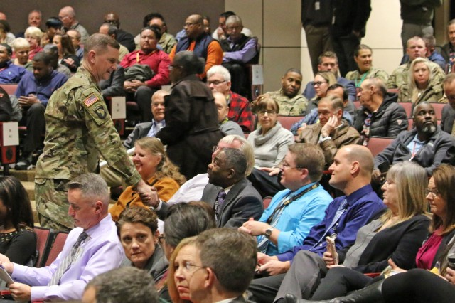 Maj. Gen. Todd Royar, commanding general of the U.S. Army Aviation and Missile Command, greets employees during a Nov. 18 Town Hall meeting.
