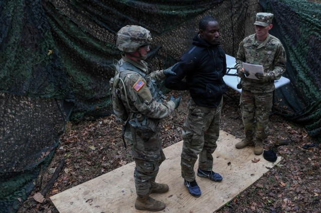 U.S. Army Spc. Keenan Baker, a military policeman with the 108th Military Police at Fort Bragg, searches a suspect during a task in the weapons lane during the Expert Soldier Badge course at Joint Base Langley-Eustis, Va., Nov. 18, 2019. To be awarded the ESB, Soldiers must pass 30 tasks designed to enhance the lethality and readiness of the force.