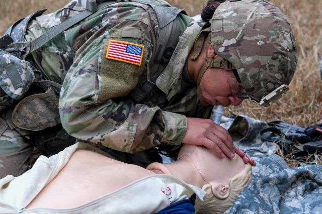 U.S. Army Staff Sgt. Claudia Huerta, a drill sergeant with Charlie Company, 4-39 Infantry Battalion, 165th Inf. Brigade at Fort Jackson, S.C., practices CPR and lifesaving procedures before being tested during the Expert Soldier Badge course at Joint Base Langley-Eustis, Va., Nov. 18, 2019. To be awarded the ESB, Soldiers must pass 30 tasks designed to enhance the lethality and readiness of the force.