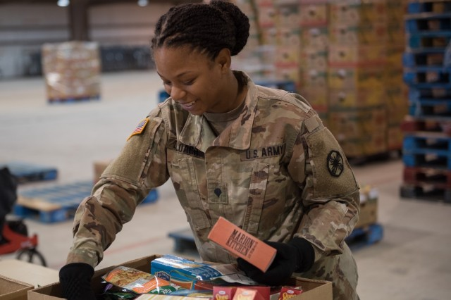 Spc. Quanita Deloach, 61st Quartermaster Battalion, helps the Killeen Food Care Center during their Food for Families food drive Nov. 22.  Food for Families is a single-day event to gather non-perishable food donations at various locations to be distributed to food banks around Central Texas.
