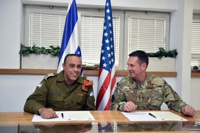 Israeli Maj. Gen. Tamir Yadaie, commanding general, Home Front Command, and Air Force Gen. Joseph Lengyel, chief, National Guard Bureau, prepare to sign the reaffirmation of a longstanding bilateral relationship between the HFC and the National Guard Bureau, Tel Aviv, Israel, Nov. 14, 2019. (U.S. Army National Guard photo by Sgt. 1st Class Jim Greenhill)