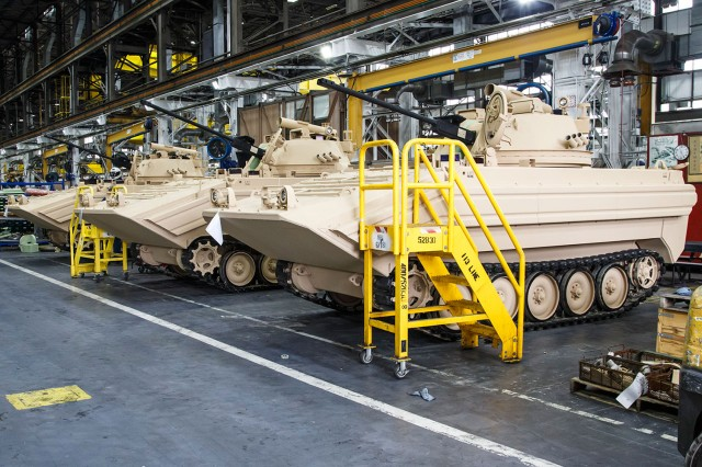 A line of M113A3/BMP-2 Opposing Forces Surrogate Vehicles await the final production step at the Combat Vehicle Repair Facility at Anniston Army Depot, Ala. The overhaul is part of the Army's improvement plan to increase readiness in the OSV Program.