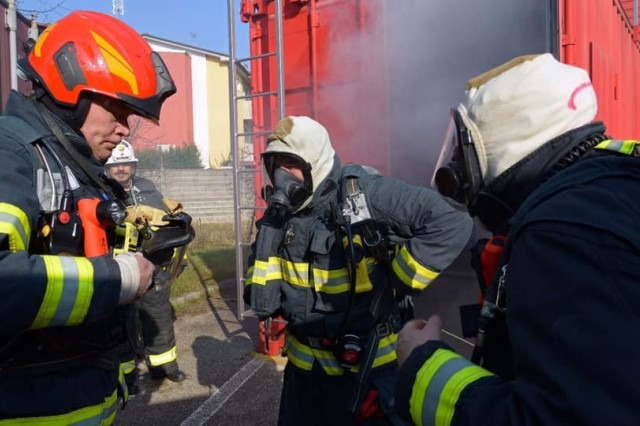 U.S. Army Garrison Italy and Italian firefighters prepare to go inside a container full of smoke in order to simulate a interior rescue of a victim that had trouble inside a container with zero visibility in Vicenza, Italy, Feb. 28, 2019. The simulation is a bilateral exercise co-hosted by USAG Italy Fire Department and Comando Vigili del Fuoco di Vicenza to improve their emergency response capabilities and bilateral work with off-post first-responders from the City of Vicenza.