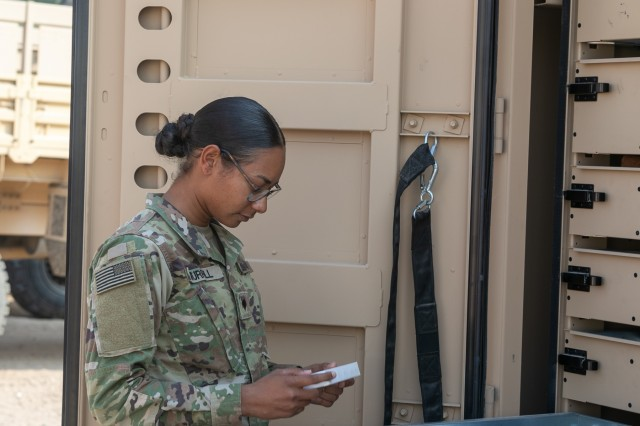 U.S. Army Spc. Tamara Murrill, a supply specialist in the 230th Brigade Support Battalion, 30th Armored Brigade Combat Team, North Carolina Army National Guard, works in the supply area supporting the 1-252 Armor Regiment in Kuwait, Nov. 25, 2019. This is the first time Murrill will be away from home during the holidays being deployed for Operation Spartan Shield.