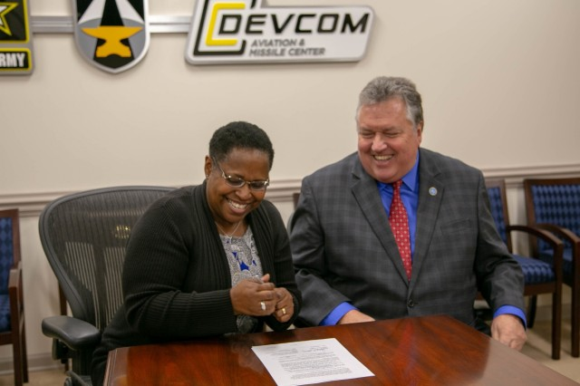 U.S. Army Combat Capabilities Development Command Aviation & Missile Center Dr. Juanita M. Christensen and Athens State University President Dr. Philip Way officially launch an educational partnership agreement between the federal agency and university with an agreement signing Nov. 21 at CCDC AvMC.