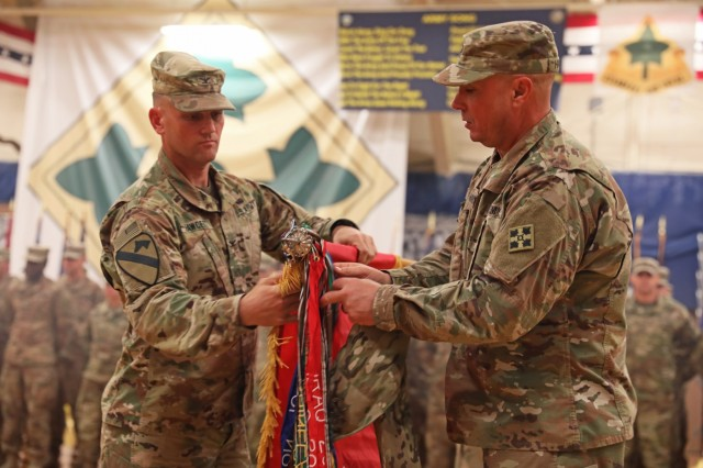 "Col. Grant S. Fawcett (left) and Command Sgt. Maj. Brian D. Haydt (right) of the 3rd Armored Brigade Combat Team, 4th Infantry Division, uncase the brigade's colors during a ceremony at Fort Carson's William ""Bill"" Reed Special Event Center on Wednesday, November 20, 2019. The brigade spent nine months deployed in support of Operation Spartan Shield before returning home in time for Thanksgiving. (U.S. Army photo by Sgt. Liane Hatch)"