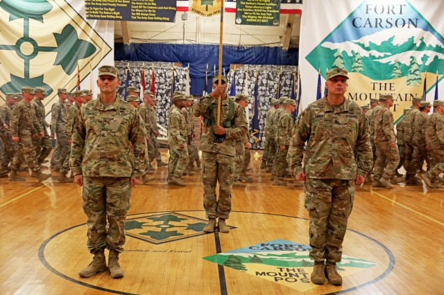 "3rd Armored Brigade Combat Team, 4th Infantry Division commander, Col. Grant S. Fawcett (left) and Command Sgt. Maj. Brian D. Haydt (right) stand in formation as approximately 300 members of the brigade march in to Fort Carson's William ""Bill"" Reed Special Event Center on Wednesday, November 20, for a redeployment and uncasing ceremony. The uncasing of the colors represents the brigade's return to Fort Carson, Colorado following a nine-month deployment in support of Operation Spartan Shield. (U.S. Army photo by Sgt. Liane Hatch)"
