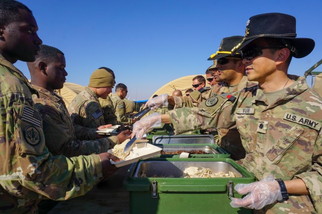Soldiers assigned to 3rd Cavalry Regiment enjoy Thanksgiving dinner on Fire Base Saham, Iraq, Nov. 20, 2018. This year, Army Central Command plans to feed about 50,000 troops, government civilians, contractors and coalition partners across its area of operations.