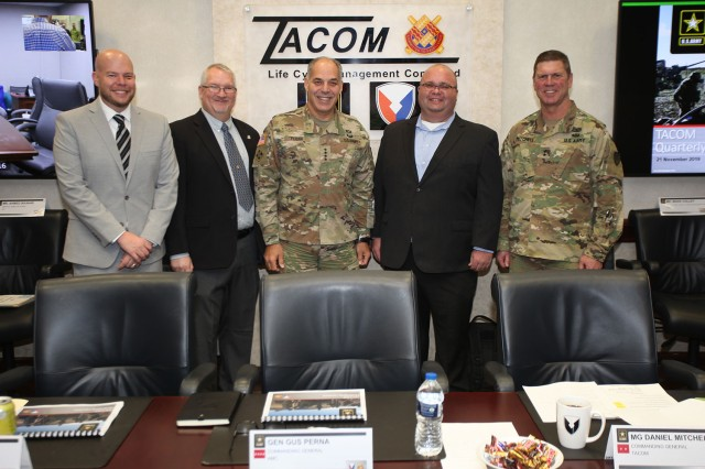 From left to right, Todd Hawotte, Steve Natole, AMC Commanding General, Gen. Gus Perna, Dave Franing, TACOM Commanding General, Maj. Gen. Dan Mitchell pose after recognition for Cross Functional Team support to Army Futures Command.
