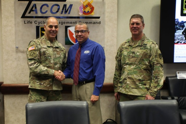 AMC Commanding General, Gen. Gus Perna (left), recognizes Mark Colley (center) for outstanding work correcting issues with the HMMWV's Wheel Assembly as TACOM Commanding General, Maj. Gen. Dan Mitchell (right) looks on.
