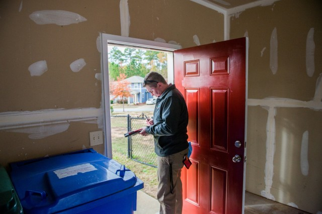 FORT BENNING, Ga. -- At Fort Benning Nov. 21, a housing inspector carries out a quality assurance inspection of a home in the Patton Village housing area with the aim of having it ready for occupancy by a military family. Fort Benning during the past year has made housing inspections much more stringent as part of a broad effort to improve on-post housing services. Most recently, as part of that ongoing effort, officials here have put in place a network of phone numbers and housing advocates residents can contact to report maintenance needs and ensure those needs are properly handled. Those steps, combined with use of an online work order system and a 24-hour housing hotline, among other avenues, are expected to markedly improve customer satisfaction with maintenance service, officials said.