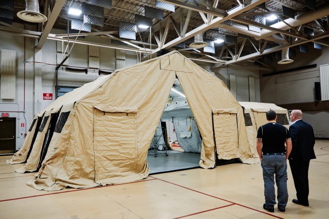 A Mass Fatality Portable Operations Center tent set up by the New York Department of Homeland Security and Emergency Services sits on display at the New York National Guard Headquarters during a workshop on mass fatality incident preparedness, Latham, N.Y., Nov. 22, 2019. Nearly 100 people are attending the day-long workshop, representing agencies from across New York from the local sheriff and fire departments, to State Police and the Department of Homeland Security, to discuss the latest trends and issues associated with mass fatality incidents.