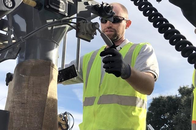 Derek Pate practices operating the Sacramento District's new sandbagging machine during training at Bryte Yard on Oct. 18.