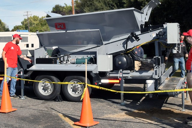 The U.S. Army Corps of Engineers Sacramento District brought their sandbagging machine to the 2nd Annual Highwater Jamboree in Sacramento on Saturday to show visitors how much faster it is than trying to fill sandbags manually. In the event of a flood-related emergency, the Corps machine can be rapidly deployed and is capable of filling up to 1000 sandbags per hour.