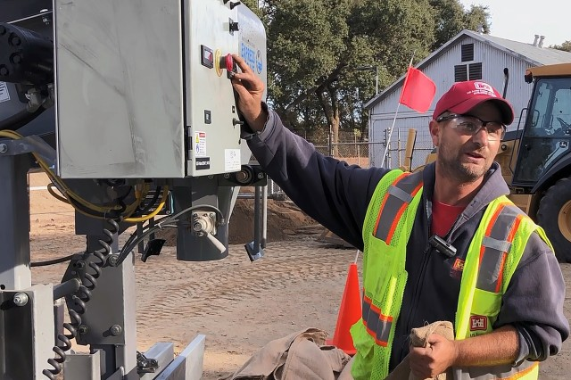 Robert Nicoson, a Maintenance Technician with U.S. Army Corps of Engineers Louisville District explains how to operate Sacramento District's new sandbagging machine as part of a Flood Fight Equipment Seminar and Drill in Sacramento on Oct. 18. Nicoson, said he has used the machine many times during flooding events, and has made at least 200,000 sand bags. The machine is capable of filling up to 1000 sandbags per hour.