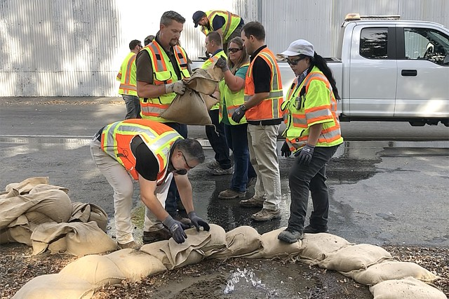 """A team of trainees works to surround a """"levee boil"""" with a barrier of sandbags. The training was included in the U.S. Army Sacramento District's Flood Fight Equipment Seminar and Drill in Sacramento on Oct. 18."""
