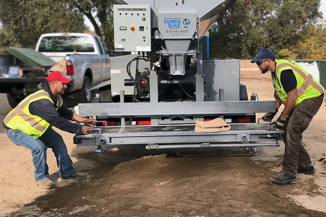 A new sandbagging machine is set up for training during a Flood Fight Equipment Seminar and Drill put on by the U.S. Army Corps of Engineers Sacramento District in Sacramento on Oct. 18. The machine is capable of filling up to 1000 sandbags per hour.