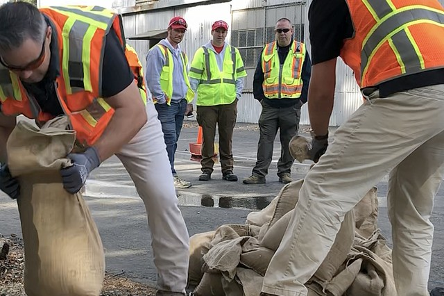 Josh Jimerfield, Nick Lesourd and Chad brown keep an eye on trainees during U.S. Army Sacramento District's Flood Fight Equipment Seminar and Drill in Sacramento on Oct. 18.