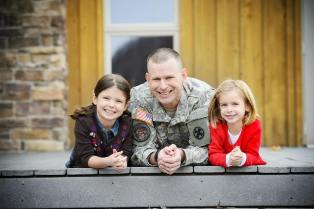 "In this photo from November 2012, Ohio Army National Guard Capt. Chris Brandt with his daughters, Katy (left, now 15) and Riley (now 12). Katy is heavily involved in her dance school and Riley plays basketball. The two girls were also recently nominated by their peers to serve as suicide interventionists under the program Hope Squad. ""If I have anything to do with it (their selection for Hope Squad), it's just because they see those same leadership qualities in my job and the amount of work that you put into making good, ethical, morally-correct decisions and understanding the impact of them,"" Brandt said."