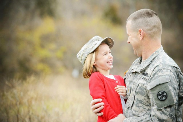 "Ohio Army National Guard Capt. Chris Brandt with his daughter Riley, who is now 12. Riley plays basketball, and she also recently was nominated by her peers (along with her sister, Katy) to serve as a suicide interventionist under the program Hope Squad. ""That was a pretty awesome thing to find out that Katy and Riley's peers think that they're people who they would feel comfortable going to, to talk about some pretty heavy-duty stuff,"" Brandt said."