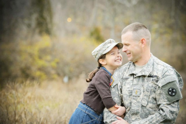 "Ohio Army National Guard Capt. Chris Brandt with his daughter Katy, who is now 15. Katy is heavily involved in her dance school, and she also recently was nominated by her peers (along with her sister, Riley) to serve as a suicide interventionist under the program Hope Squad. ""That was a pretty awesome thing to find out that Katy and Riley's peers think that they're people who they would feel comfortable going to, to talk about some pretty heavy-duty stuff,"" Brandt said."