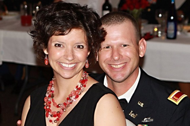 "Ohio Army National Guard Capt. Chris Brandt with his wife, Jen. Chris and Jen met in graduate school and got married on Sept. 15, 2001. ""He sets a very positive example of what it means to be American for our daughters,"" said Jen Brandt, who comes from a long line of military members in her family. ""Chris sets a very positive example of what it looks like to serve for our daughters."""