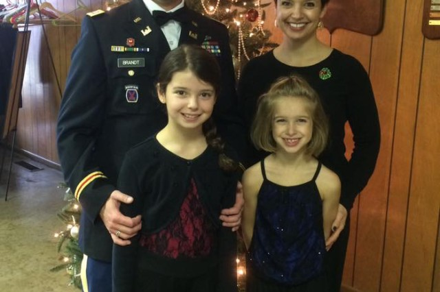 "Ohio Army National Guard Capt. Chris Brandt with his wife, Jen, and daughters: Katy, (left)  and Riley. Chris and Jen met in graduate school and got married on Sept. 15, 2001. ""He sets a very positive example of what it means to be American for our daughters,"" said Jen, who comes from a long line of military members in her family. ""Chris sets a very positive example of what it looks like to serve for our daughters."""