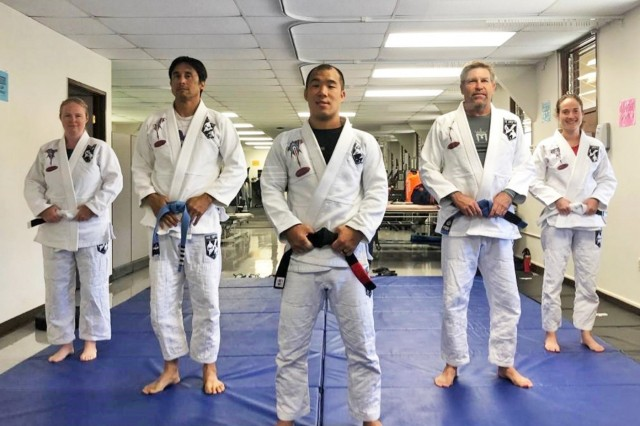 U.S. Army Staff Sgt. Peter Wang, Brazilian Jiu Jitsu program director and instructor (front and center) poses with (left to right) Kristy Arnold, Assistant Instructor Peter Robles  Assistant Instructor Steve Streifel, and Kristi Smith. (Photo courtesy, Warrior Transition Battalion, Schofield Barracks, Hawaii)