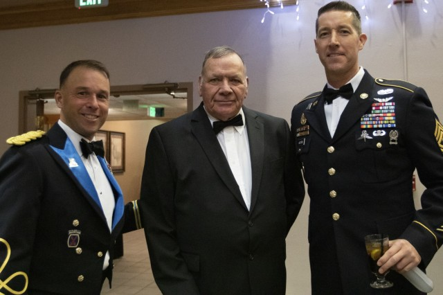 Lt. Col. Patrick Miller, left, 303rd Military Intelligence Battalion commander, Ret. Command Sgt. Maj. Dan Morelock, middle, former 303rd MI BN CSM, and Command Sgt. Maj. Kevin Austin, right, 303rd MI BN CSM, pose for a photo, Nov. 22, 2019, Fort Hood, Texas. All were reminiscing about the early days of the 303rd MI BN on Fort Hood. (U.S. Army photo by Sgt. Melissa N. Lessard)