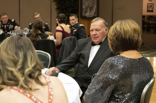 Ret. Command Sgt. Maj. Daniel Morelock listens to conversation during a ball, Nov. 22, 2019, Fort Hood, Texas. Dan served with the 303rd MI BN on two separate occasions from 1978-1985. (U.S. Army photo by Sgt. Melissa N. Lessard)