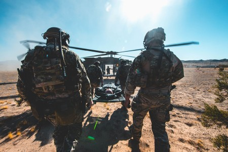 Special Operations Soldiers with 3rd Special Forces Group (Airborne) load a simulated casualty onto a UH-60 Black Hawk at Marine Corps Air Ground Combat Center, Twentynine Palms, Calif., Oct. 21, 2019. The Green Berets used the MCAGCC training areas to refine detachment tactics and prepare for combat operations.