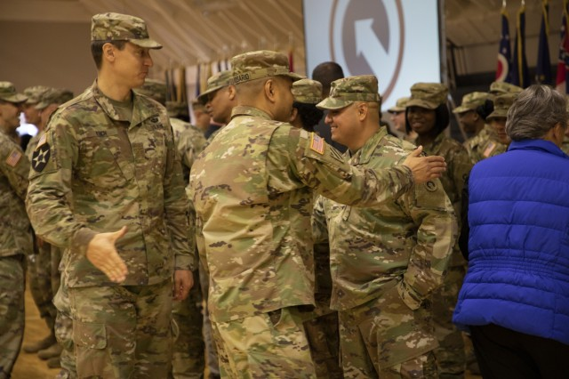 """1st Theater Sustainment Command (TSC) Soldiers shake hands and say goodbye to Master Sgt. Edgar Ocegueda, maintenance management branch NCOIC, 1st TSC at a deployment ceremony Nov. 26, 2019 at Sadowski Center on Fort Knox, Ky. Ocegueda will be deploying with the Strategic Operations and Plans (SOaP) """"Blue Team"""" to the U.S. Central Command (CENTCOM) area of operations. (U.S. Army photo by Wendy Arevalo)"""