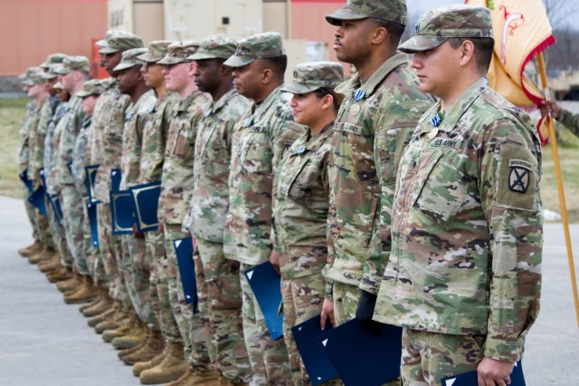 10th Combat Aviation Brigade Soldiers received awards for their outstanding support during the initial pushout of the CAB's deployment, Nov. 26, Fort Drum, N.Y. They were all pinned by Lt. Col. Matthew Parker, 277th Aviation Support Battalion commander.