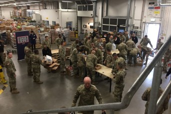 350 service members receive Thanksgiving meal baskets