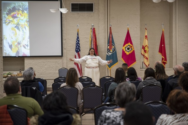 Guest speaker Kim Sigafus McIver shares facts about her Ojibwa culture during the National American Indian Heritage Month Observance held at Rock Island Arsenal, Illinois, Nov. 21. (Photo by Linda Lambiotte, ASC Public Affairs)