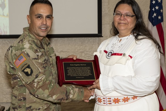 Command Sgt. Maj. Marco Torres, U.S. Army Sustainment Command, presents Kim Sigafus McIver, guest speaker at the National American Indian Heritage Month Observance, with a plaque of appreciation at Rock Island Arsenal, Illinois, Nov. 21. (Photo by Linda Lambiotte, ASC Public Affairs)