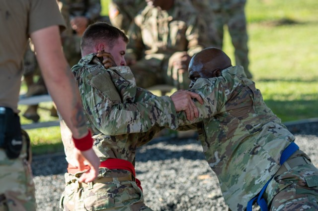 Army Pfc. Pascal Anderson (red belt), Troop Command C Company, competes against Army Spc. Mo Suleiman, Troop Command B Company, during the combatives portion of the Brooke Army Medical Center Soldier of the Year competition Nov. 19, 2019. Anderson went on the win the title of BAMC's Soldier of the Year.