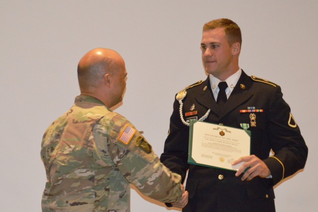 Army Col. Joseph Novak, Brooke Army Medical Center deputy commander for medical services, congratulates Army Pfc. Pascal Anderson, Troop Command C Company, for being chosen as BAMC's Soldier of the Year during a ceremony Nov. 22, 2019. Anderson is a radiology specialist from Cologne, Germany.