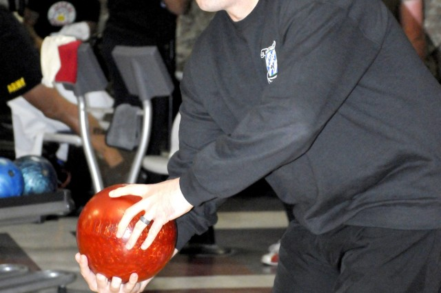 Sgt. 1st Class Stuart Walters, Task Force 1-28 Infantry from Fort Benning throws a strike during the Marne Week Bowling competition, Nov. 19 on Fort Stewart.