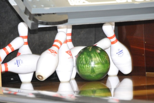 Pins fly during the 3rd Infantry Division Bowling competition, Nov. 19 at Marne Lanes.  The event featured teams of four-members representing units from across the division, Fort Stewart-Hunter Army Airfield and Fort Benning - competing for high score.