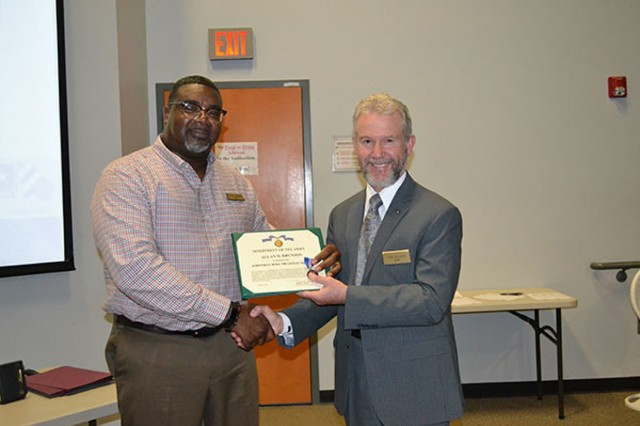 DHR Director Thomas Allmon (right) congratulates DHR Employee of the Quarter for 4th Quarter and Fiscal Year 2019, Alan Brunson, for outstanding efforts during the DHR All-Hands Employee Recognition Ceremony, Oct. 17, on Fort Stewart. (Photo by Angela Hinton-Robinson)