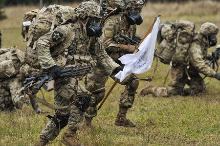 Paratroopers assigned to 91st Cavalry Regiment, 173rd Airborne Brigade, advance into the woodline while participating in the unit's Spur Ride in Grafenwoehr Training Area, Germany, Nov. 20, 2019. The�Spur Ride�is the only means of joini...