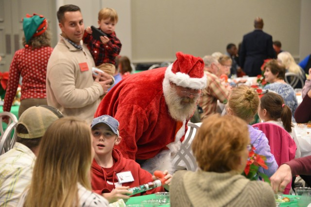Santa Claus visits with family members during U.S. Army Space and Missile Defense Command's Survivor Outreach Services Holiday Party at the Botanical Gardens in Huntsville, Alabama, Nov. 22. (U.S. Army photo by Jason B. Cutshaw)