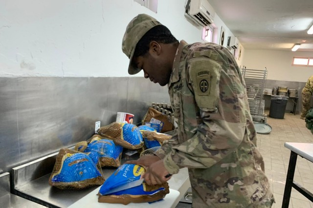 A Culinary Specialist assigned to the 82nd Brigade Support Battalion, 3rd Brigade Combat Team, 82nd Airborne Division prepares turkeys at a remote base in Uruzgan Province, Southern Afghanistan on Thursday, November 28, 2019.  The Culinary Specialist was preparing the food for the battalion's Thanksgiving feast scheduled later in the day.